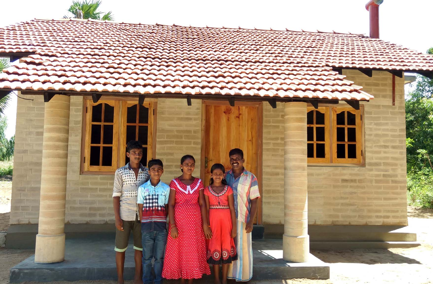 A first beneficiary family to receive a Habitat home constructed with the use of Compressed Stabilized Earth Blocks (CSEB) in Batticaloa.
